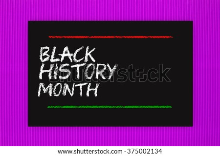 Black History Month Blackboard hanging on purple textured background - stock photo