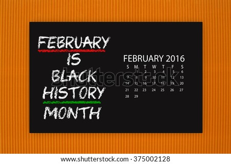 Black History Month February 2016 Calendar Blackboard hanging on orange textured background - stock photo