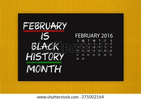 Black History Month February 2016 Calendar Blackboard hanging on yellow textured background - stock photo