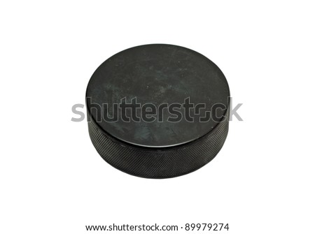 Black hockey puck isolated on white background - stock photo