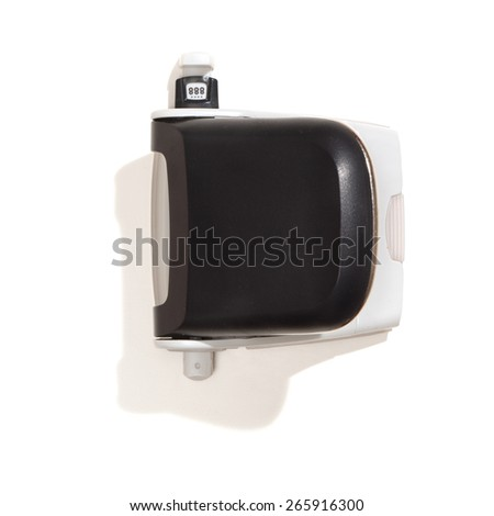 Black hole-puncher or perforator. Top view, isolated on white background. - stock photo
