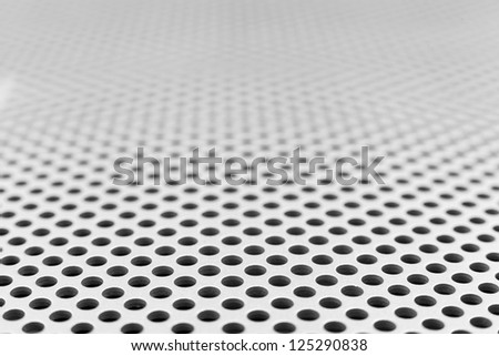 Black holes in silver material disappearing in the horizon - stock photo