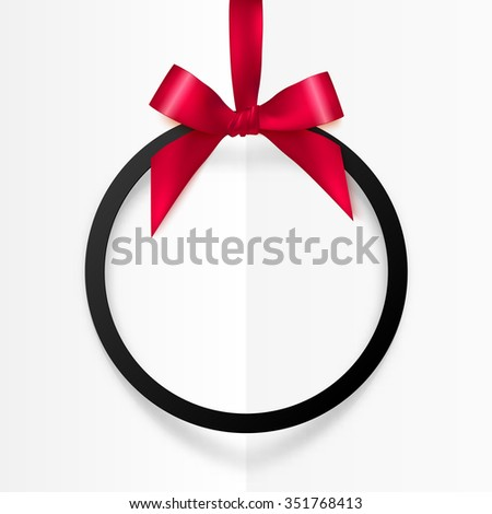Black holiday round frame with red bow and silky ribbon