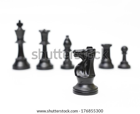 Black horse chess with blur chess figure background - stock photo