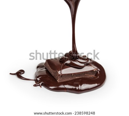 black hot chocolate pouring onto a piece of chocolate on a white background isolation  - stock photo
