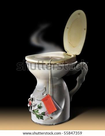 Black humor. Cup of non drinking tea. - stock photo