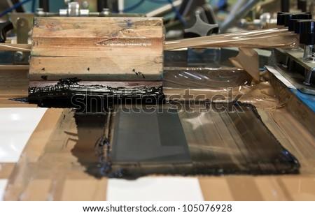 black ink on  hand printing machine - stock photo