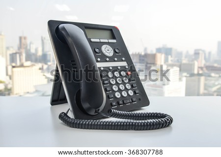 Black IP Phone on the white table