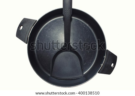 Black Iron cooking pan and spatula,top view,isolated on white background - stock photo