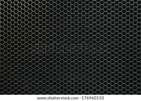 Black iron hexagonal texture. Industrial background