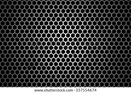 Black iron speaker grid texture.