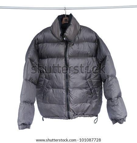 Black jacket on the rack, isolated on white background, selective focus. - stock photo