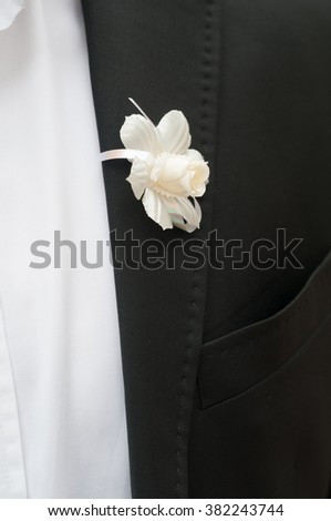 Black jacket with white flower