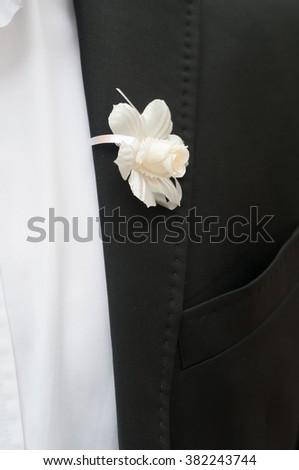 Black jacket with white flower - stock photo