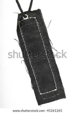 Black jeans tag with lace isolated on white background - stock photo