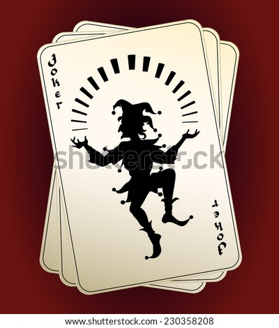 Black Joker silhouette on a hand or deck of playing cards  designated as the highest trump or wild card conceptual of a casino  gambling and luck - stock photo