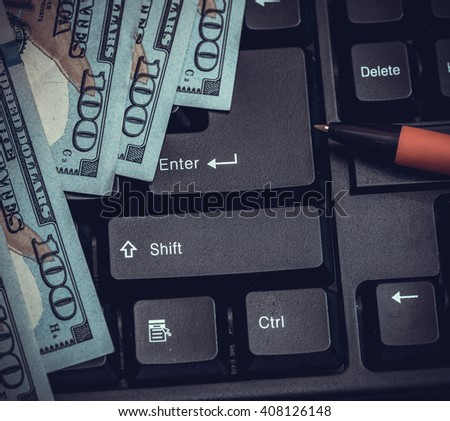 black keyboard with american dollar, pen. toned image