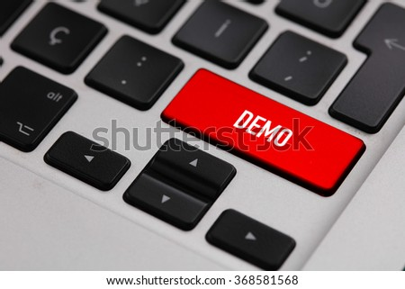 Black keyboard with red DEMO button - stock photo