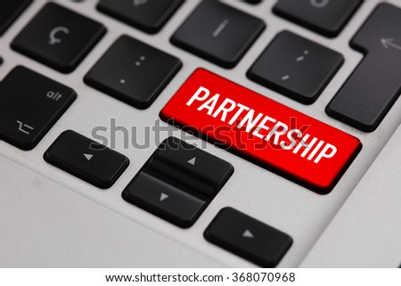 Black keyboard with red PARTNERSHIP button - stock photo
