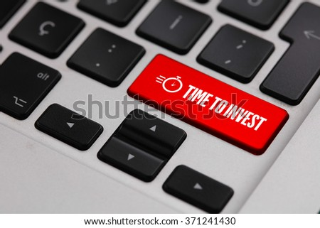 Black keyboard with TIME TO INVEST button - stock photo