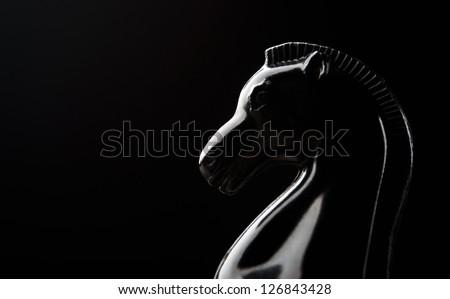 black knight chess piece on background - stock photo