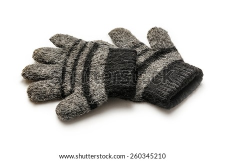 Black knitted gloves for winter on white background - stock photo