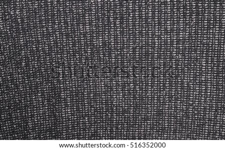 Black knitted wool background and texture