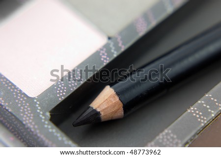 black kohl eye liner pencil on Beauty-case - stock photo