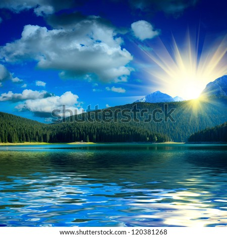 Black lake near by mountians - stock photo
