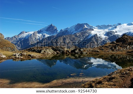 Black Lake, plateau de Paris in Alps, France This is i beautiful small lake called Black lake on the plateau de Paris in the Alps in France - stock photo