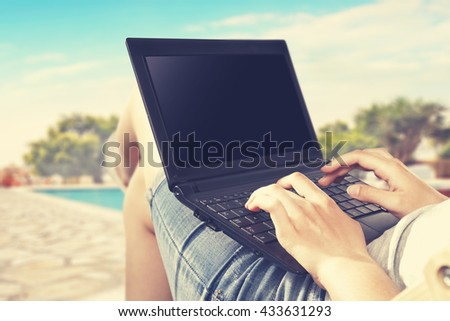 black laptop and pool and hands and free place