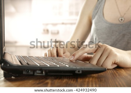 black laptop and woman hands
