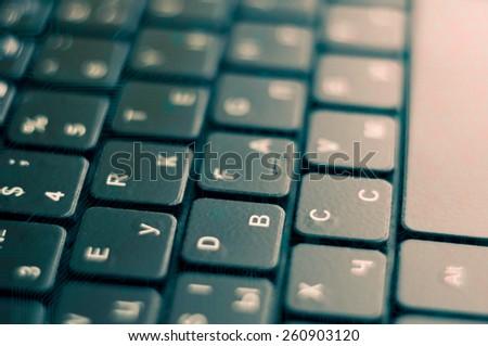 black laptop keyboard. Tech background. Blur. - stock photo