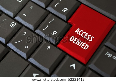 black laptop keyboard with a button the access denied - stock photo