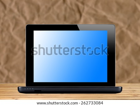 Black laptop over bright office background - stock photo