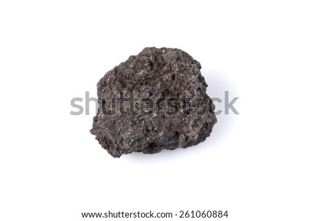 Black lava rock from volcano on a white background - stock photo