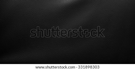 black leather background.