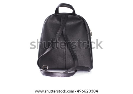 Black leather backpack standing in the studio on a white background.