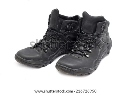 black leather boots on white background - stock photo