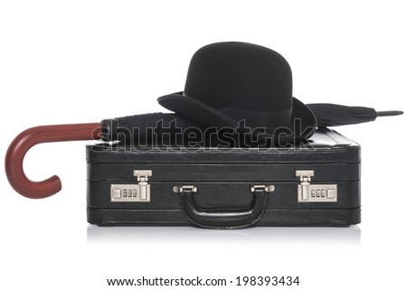 Black leather briefcase with bowler hat and umbrella, isolated on a white background. - stock photo