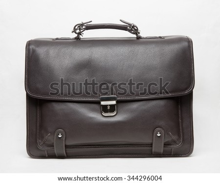 black leather elegant briefcase isolated - stock photo