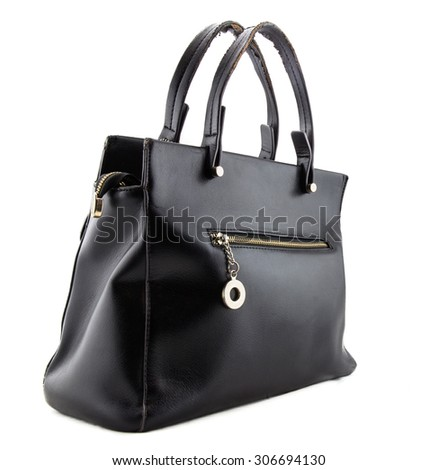 Black leather female bag on white background.