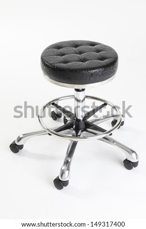 Black leather hair dresser or barber shop stool - stock photo
