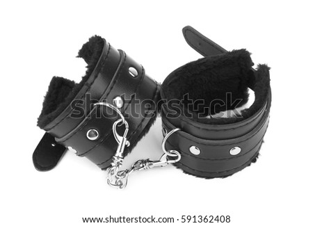 black leather handcuffs isolated on white background