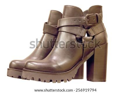 Black leather high-heeled womanish boots isolated on white background. - stock photo