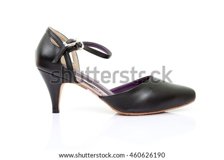 Black leather high heels isolated on white background