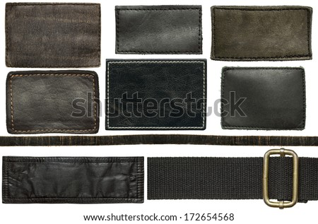 Black leather jeans labels and straps - stock photo