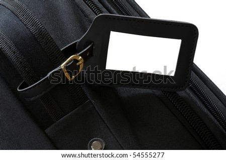 black leather label on a black suitcase - stock photo