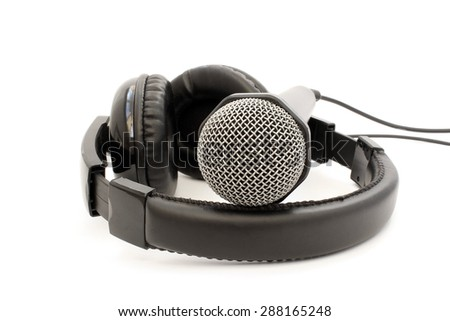 Black leather microphone and headphones on a white background