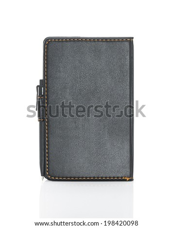 Black leather note book and pen with shadow on white background